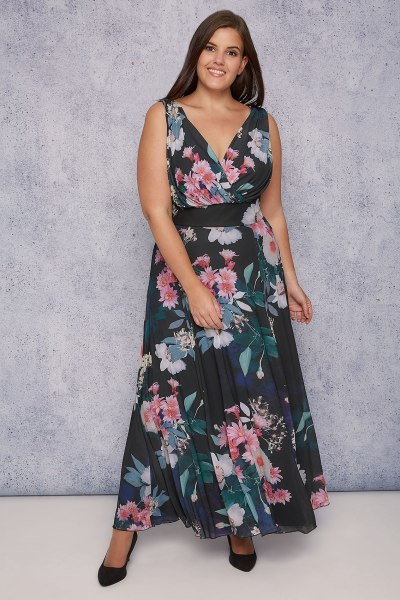Plus size brunette model wearing Scarlett & Jo maxi dress