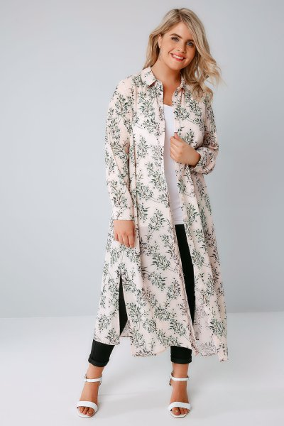 Plus size model wearing full length duster shirt