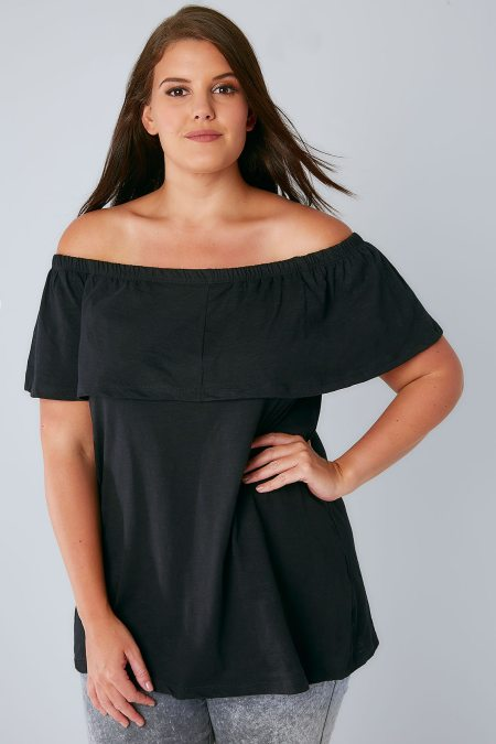 Plus size brunette model wearing bardot top