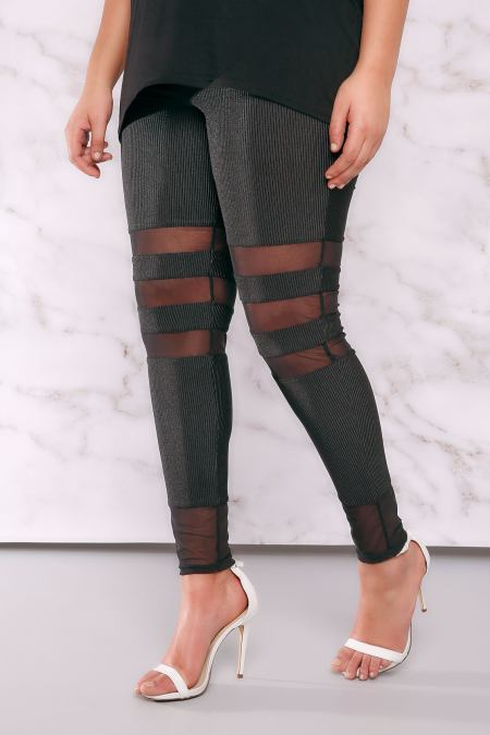 Plus size model wearing sports luxe leggings