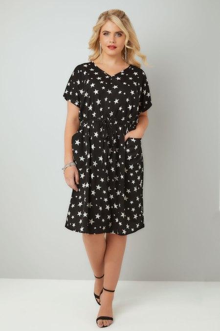 Plus size model wearing dress