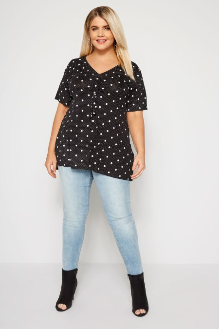 Our model wearing our Black Polka Dot Ruched Front T-Shirt
