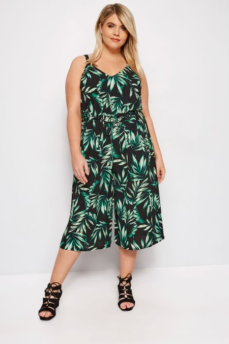 Our model Rachael wearing our black palm leaf jumpsuit