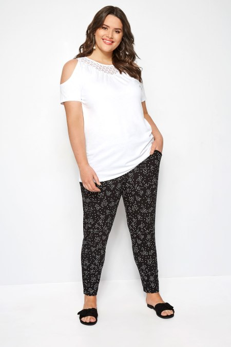 Our model wearing our Black & White Double Pleat Spot Harem Trousers