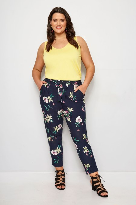 Our model wearing our navy floral tapered trousers