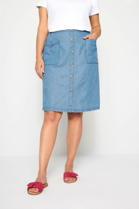 Our model wearing our denim chambray button skirt