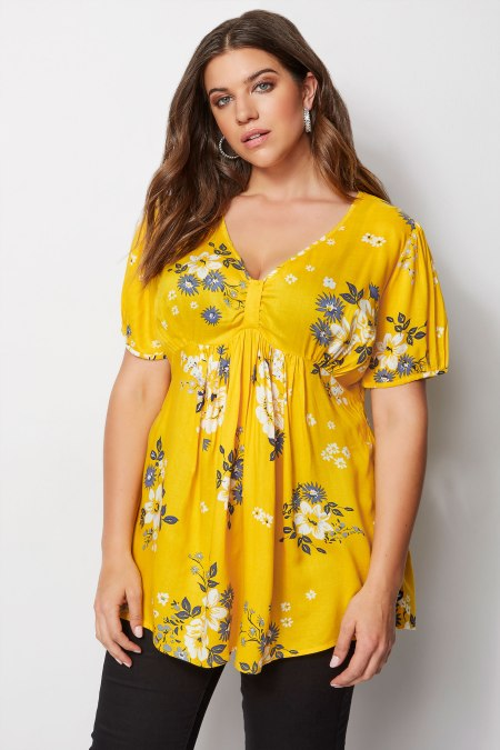 Our model wearing our Yellow Floral Tea Blouse