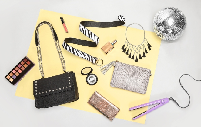 A flat shot of accessories including bags, belts and necklaces